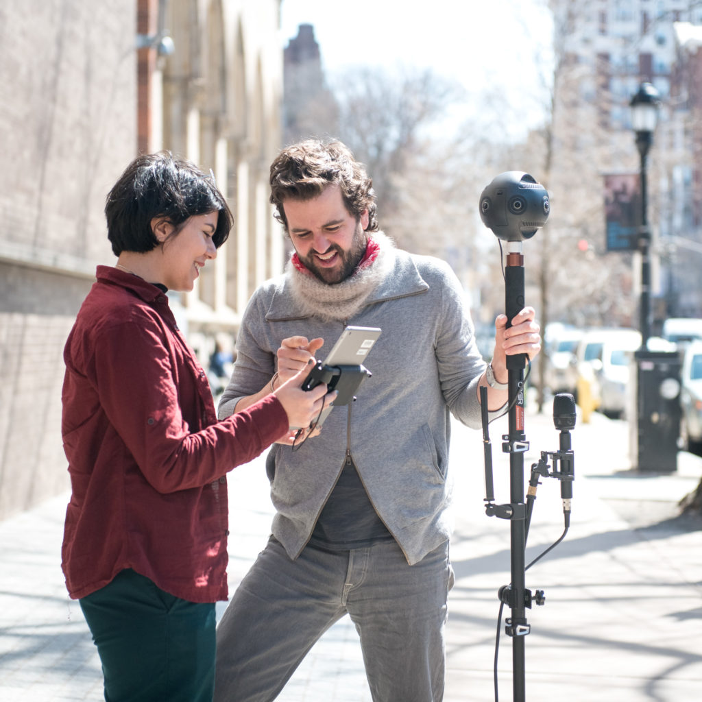 A man and a woman testing a 360 video setup.