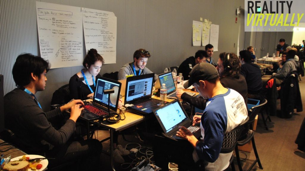 A large group of people working on laptops.